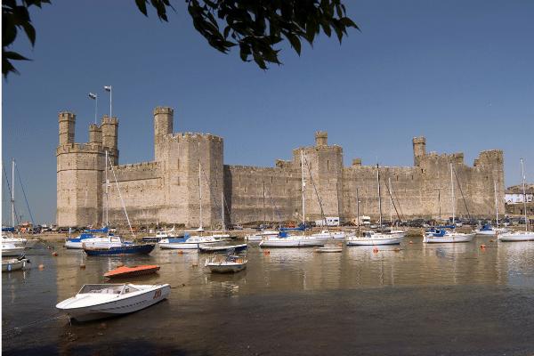 A view of Caernarfon Castle across the bay